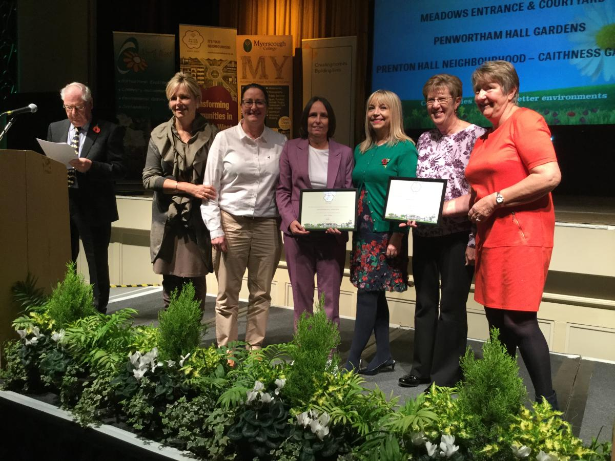 Residents from Caithness Gardens accepting their award