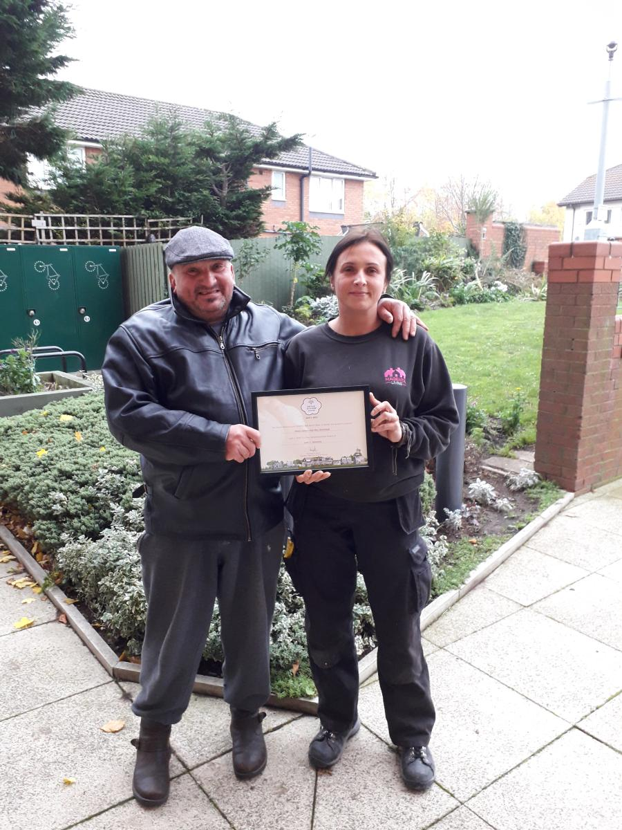 Jozef and his daughter, Pat, with his award for this vegetable garden