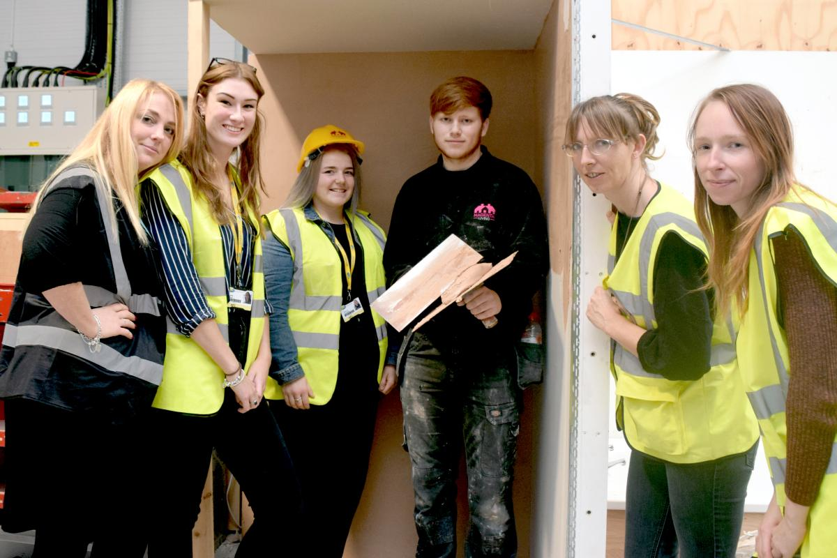 Students at Wirral Met with plasterer, Joe Hunt