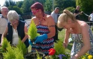 Tenants making hanging baskets at a Magenta Living community event