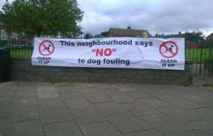 Say No to dog fouling poster at a community event