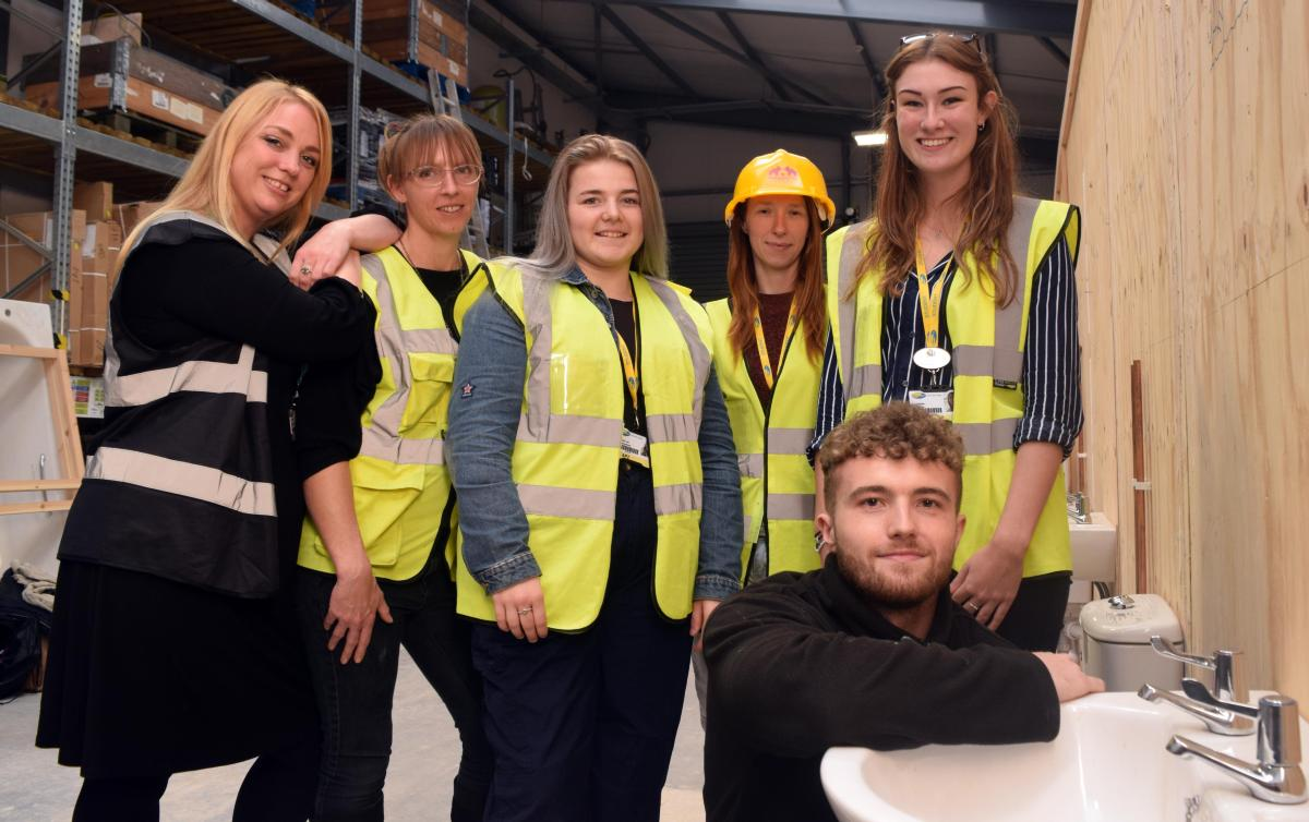 Apprentice Plumber David pictured with attendees of Women in Construction Event